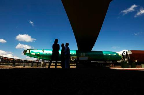Boeing airplane fuselages roll on the rail through Denver - The Denver Post